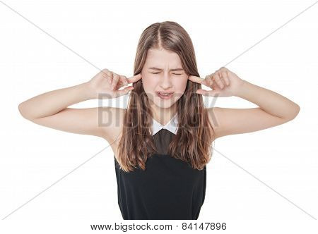 Young beautiful teenager girl plugging ears with fingers isolated on white background poster