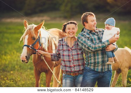 Happy family resting in the summer in the countryside.