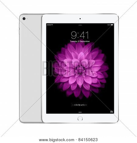Apple Silver Ipad Air 2 With Ios 8 With Lock Screen On The Display, Designed By Apple Inc.