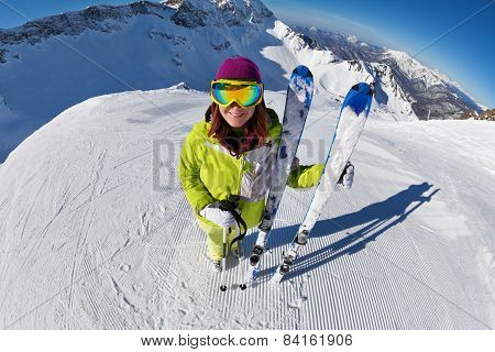 View of woman in mask standing and holding ski