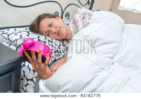 cute young girl waking up in bed