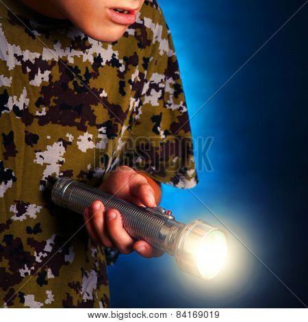 Teenager With Flashlight
