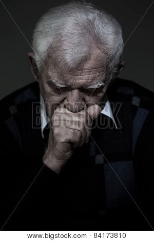 Portrait of old aged man who mourns his wife poster