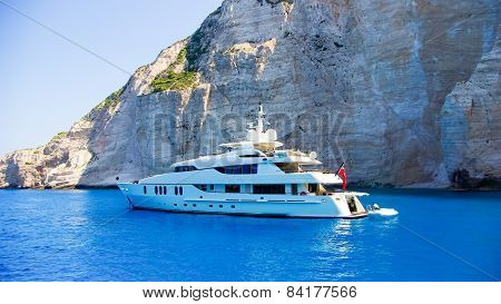 Luxury White Yacht Navigates Into Beautiful Blue Water Near Zakynthos Island, Greece.