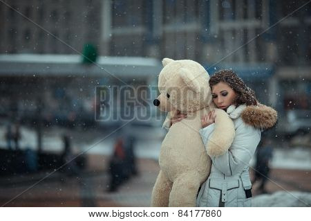 Girl With A Bear During Snow.