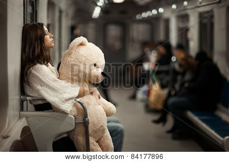Girl With Bear In A Subway Car.