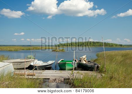 Boats Moored To A Wooden Planked Footway, Karelia Region, Russia