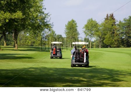Two golf carts heading for the next tee