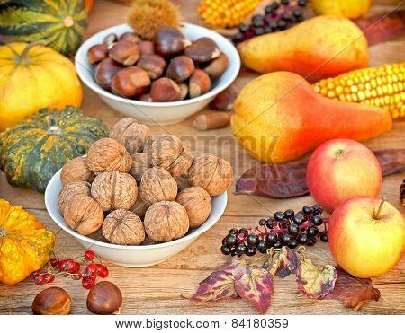 Autumn harvest - Autumn fruitage on wooden table poster