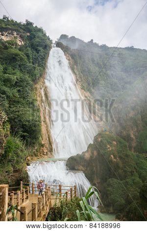 Girl Looking At Waterfall In Motion, Beautiful Velo De La Novia, Chiapas. Traveling Through Mexico.
