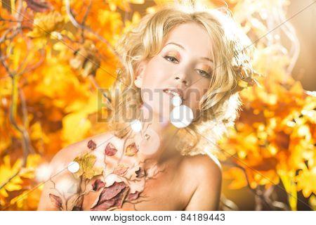 Magic gold autumn blonde girl portrait in leafs