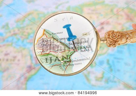 Blue tack on map of Asia with magnifying glass looking in on Baki or Baku Azerbaijan poster