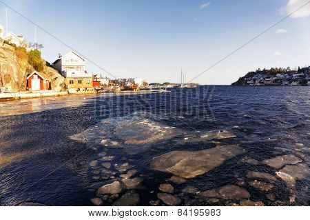 Ice Floes On Waves Fjord