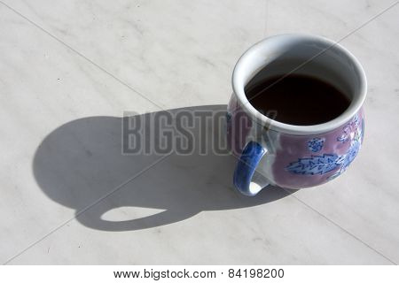 Coffee Cup On A Sunny Table