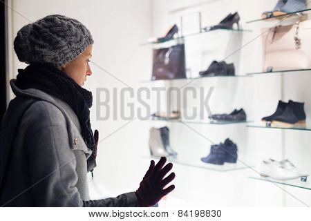 Woman window shopping.