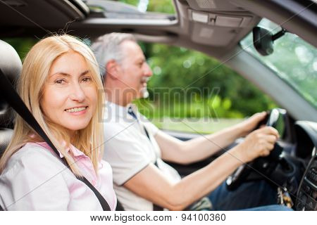Mature couple traveling in their car