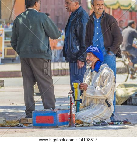 TAROUDANT, MOROCCO, APRIL 9, 2015: Local man in traditional attire give performance playing music on square