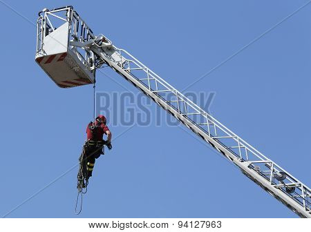 Firefighter With The Rope Climbing In Firehouse