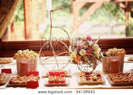 Table Setting With Flowers And Sweets