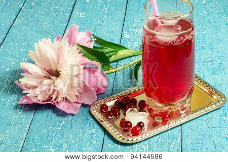 Peony And A Cold Drink With Cranberry Juice And Ice