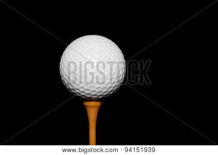 Golf Ball On Tee-peg On Black Background