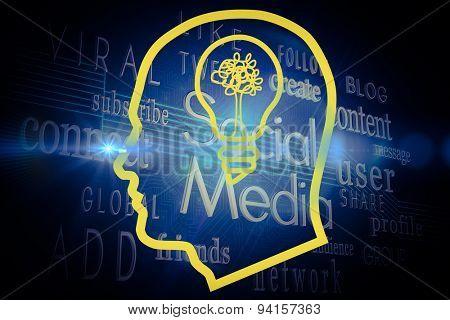 Light bulb in head against social media buzzwords on black background