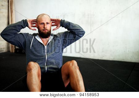Muscular Man Concentrating On Situps
