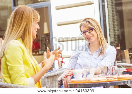 Young Women Have Coffee Break Together