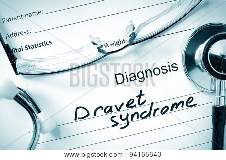 Paper with diagnosis Dravet syndrome  and tablets. Medicine concept. poster