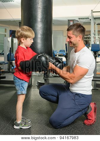 man and son in the gym