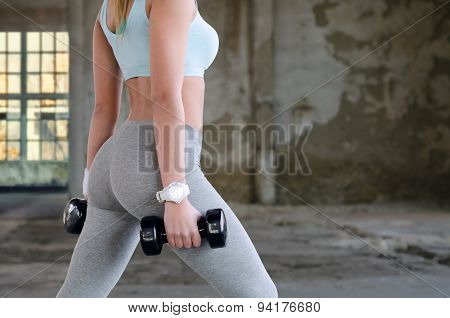 Body Of The Fitness Girl Exercising In Abandoned Buildng