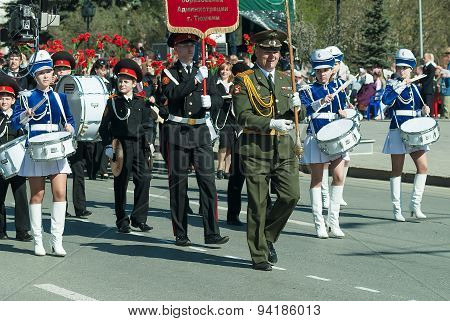 Tyumen, Russia - May 9. 2009: Parade of Victory Day in Tyumen. Cadet military orchestra plays and walks on Victory Day parade poster
