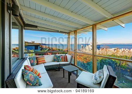 Perfect Tacoma Waterfront House Exterior With Winter Decor. Open Deck With Great Sofa.