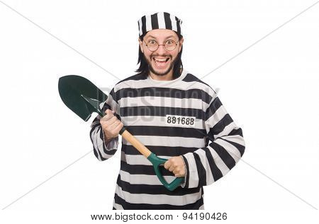 Prison inmate with spade isolated on white