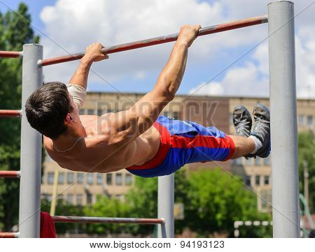 Unidentified Athlete Performs Acrobatic Element During The Street Workout Championship At Krivoy Rog