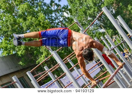 Unidentified Sportsman Performs Acrobatic Element During The Street Workout Championship At Krivoy R