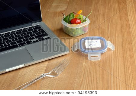 Salad at Busy Office Worker's Desk or Home Office
