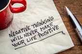 negative thinking will never make your life positive - inspirational handwriting on a napkin with a cup of coffee poster