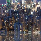 Background of blurred skyscrapers at night with reflection on the roof of building in Hong Kong, shallow depth of focus. poster