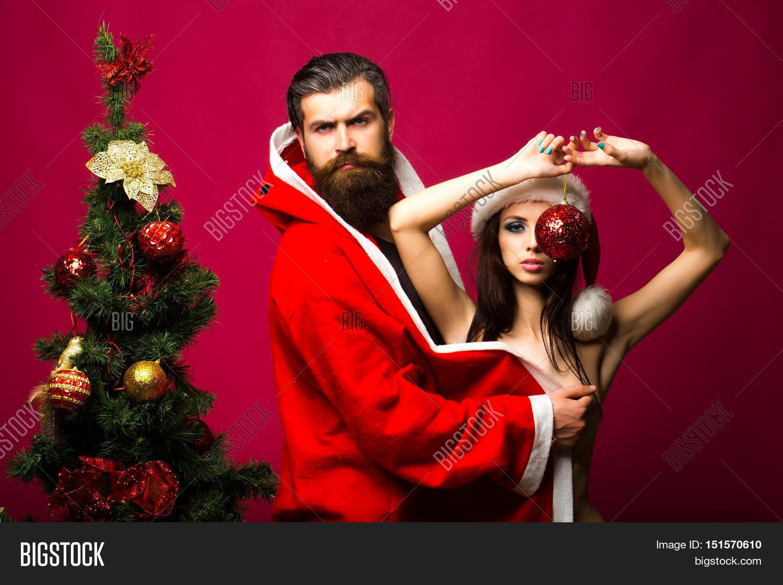 christmas couple near new year tree