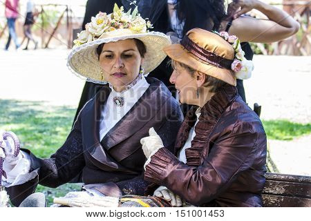 CAGLIARI, ITALY - May 29, 2016: Sunday at La Grande Jatte VIII Ed. At the Public Gardens - Sardinia - group of women in Victorian costumes