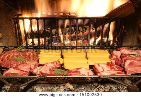 Bovine Raw Meat And Pork Meat Cooking In The Fireplace