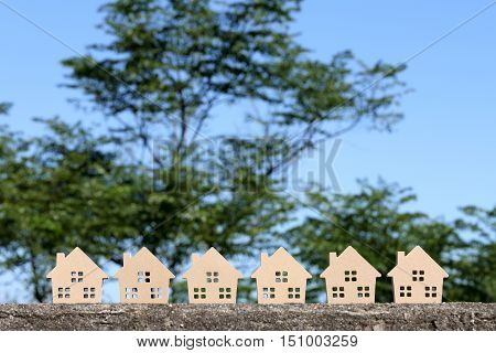 wooden toy houses with tree and blue sky background