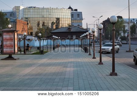 Tyumen, Russia - May 14, 2005: Square with lanterns in front of Regional philharmonic hall on Chelyuskintsev street. On background is Tyumen State University