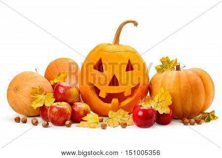 pumpkin-head nuts apples and yellow leaves isolated on white background
