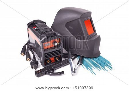 Inverter welding machine, welding equipment isolated on a white background, welding mask, set of accessories for arc welding