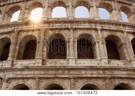 Coliseum fragment over beautiful blue sky Rome Italy
