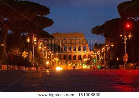 View on the Coliseum through the street in the evening. Rome Italy