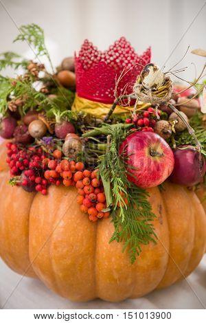 Beautiful thanksgiving centerpiece. Autumn pumpkin flower arrangement centerpiece.