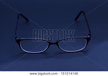 Eyeglasses fashion in a black background .